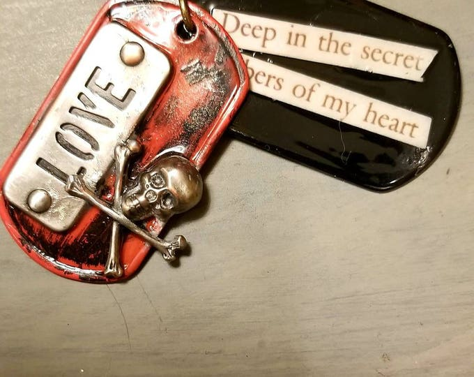 Love tags. Love skull and crossbones Dog tags red and black. Deep in the secret chambers of my heart. Gothic dog tags