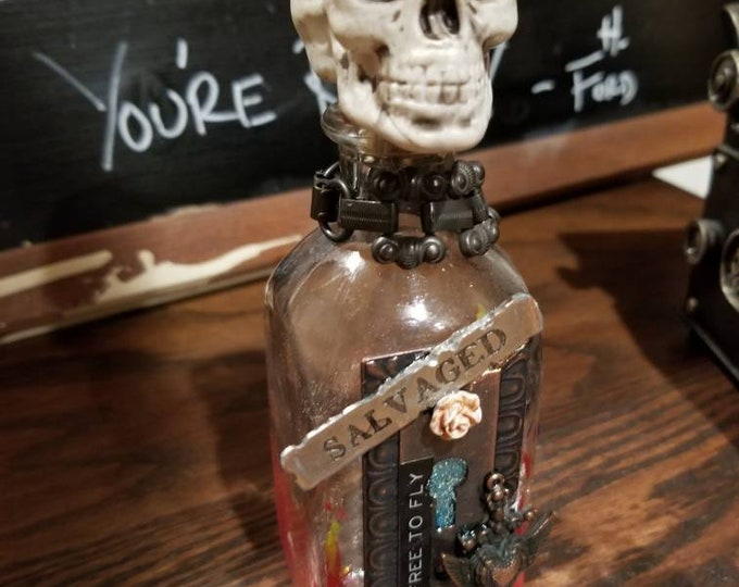 Salvaged skull top apothecary bottle
