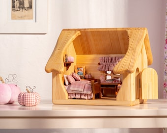 Wooden doll house with furniture and pink textile - supernatural gifts