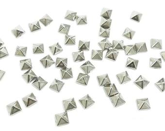 15 pcs Pyramidal metal studs, silver finish.