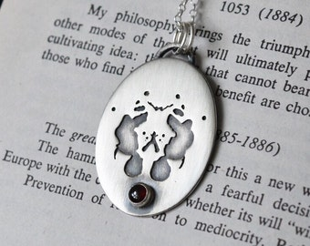 Sterling Silver and Garnet Rorschach Necklace