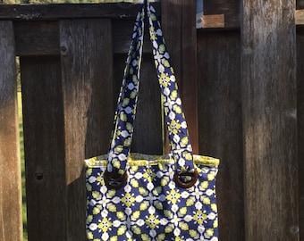 Tile Pattern Grommet Handbag