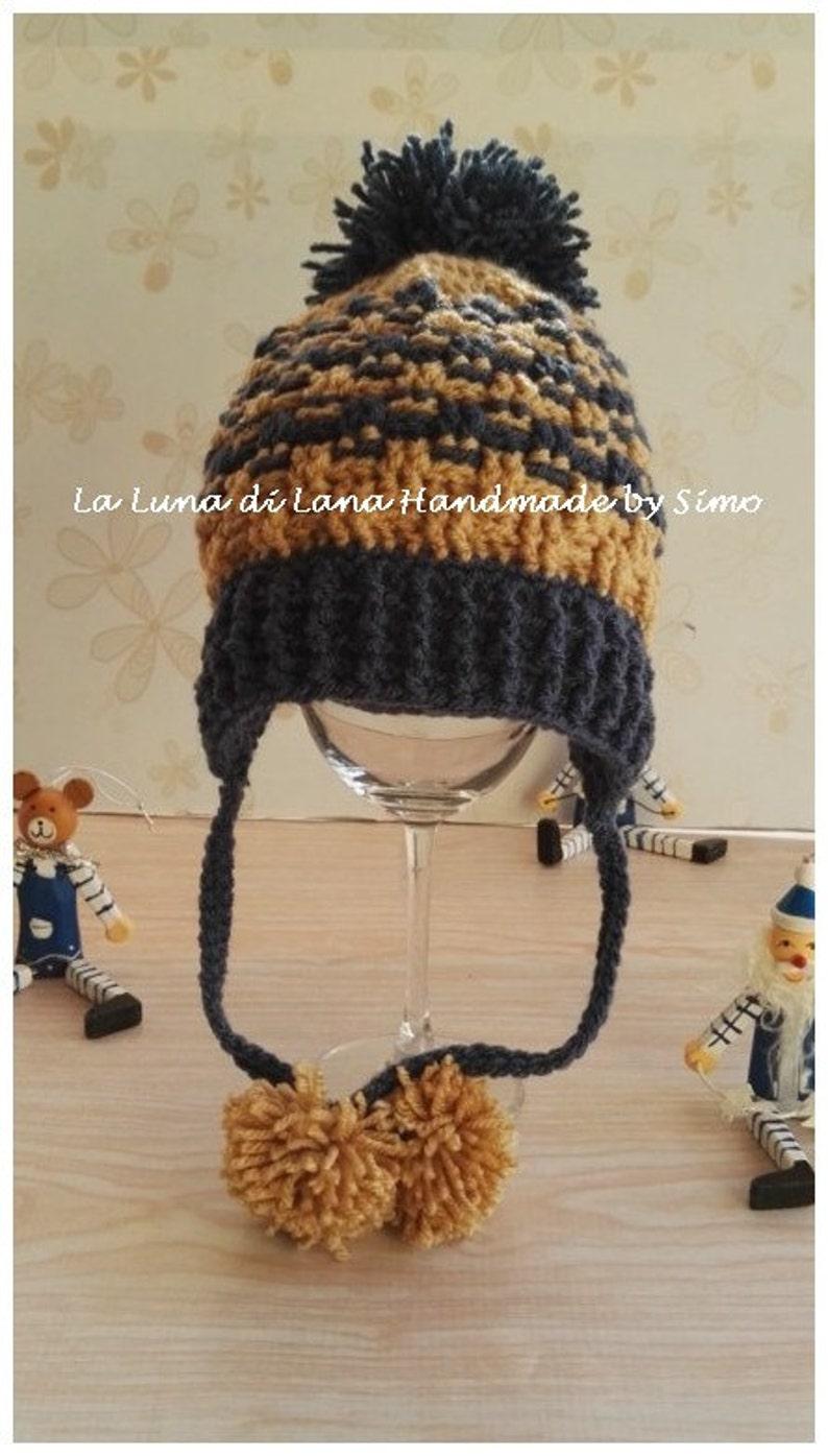 Cappello di lana con paraorecchie per bimbo cappello pon pon  528e0f0da709