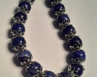 Blue bead bracelet w/ flower spacers