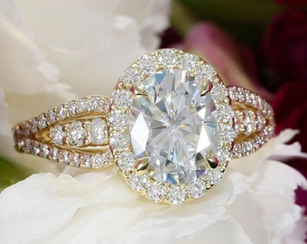9x7mm Oval Forever One Moissanite and Diamond Halo Engagement Ring in 14k Yellow Gold (avail. in rose, white, yellow gold and platinum)