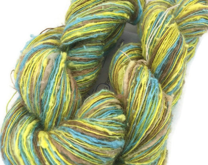 Hand-dyed rayon slub, 400 yard skeins, in yellow, brown, and blue -075