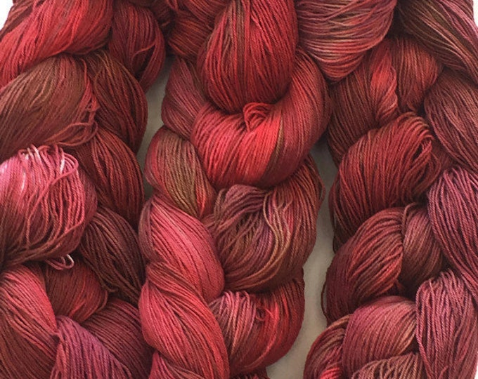 Hand-dyed, pre-wound weaving warp, 10/3 cotton, 300 ends, 5 7/8 yards long, in shades of reds and brown -DW96