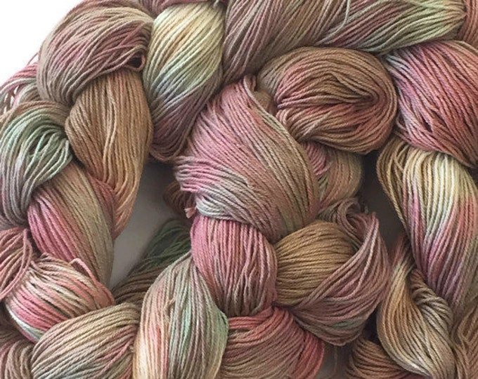 Hand-dyed, pre-wound weaving warp, 10/3 cotton, 300 ends, 3 7/8 yards long, in shades of beige, pink, and green -DW92
