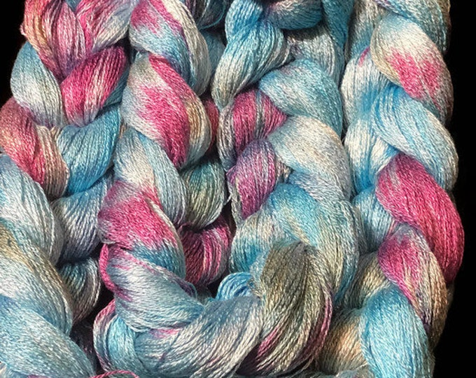 Hand-dyed, pre-wound weaving warp, 8/2 rayon, 300 ends, 7 3/4 yards long, in shades of bright blue, red purple, and moss green - DW212