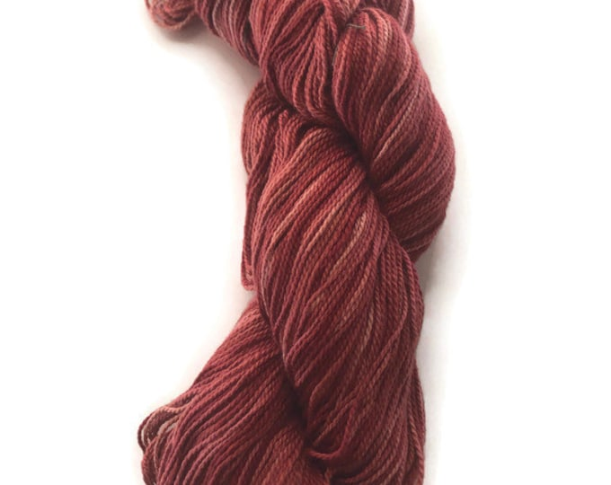 Hand-dyed 2-ply cotton, 400 yard skein, in shades from pink to rust red