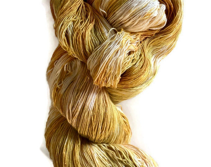 Hand-dyed 16/3 cotton yarn, 1200+ yards, in shades of yellow, orange-yellow, golden yellow, and natural