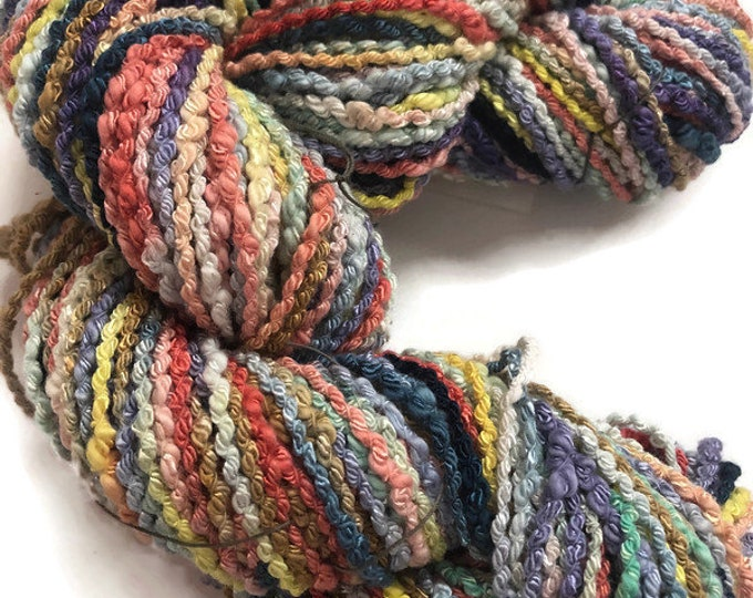 Hand-dyed cotton/rayon popcorn yarn, boucle, in many colors and shades of yellow, pink, orange, lavender, green, navy, and brown