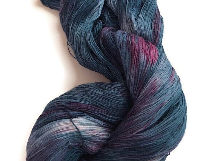 Hand-dyed 16/3 cotton yarn, 1200+ yards, in shades of dark navy blue, blue, purple, and red purple