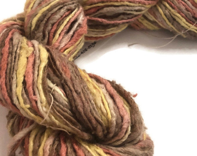 Hand-dyed, cotton and rayon yarn, thick and thin, single ply, in shades of yellows, oranges, and browns