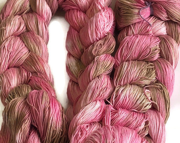 Hand-dyed, pre-wound weaving warp, 6.5/3 mercerized cotton, 300 ends, 6 1/2 yards long, in shades of pinks and browns
