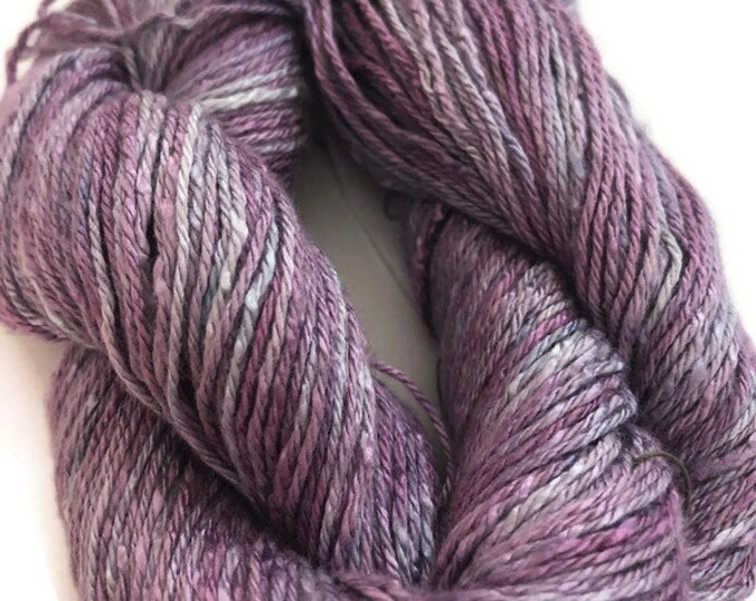 Hand-dyed cotton/rayon 3-ply yarn in shades of lavender and purple