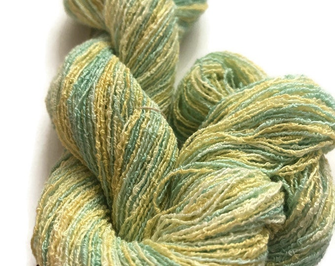 Hand-dyed, cotton and rayon boucle yarn, 300 yard skein, in shades yellow and green