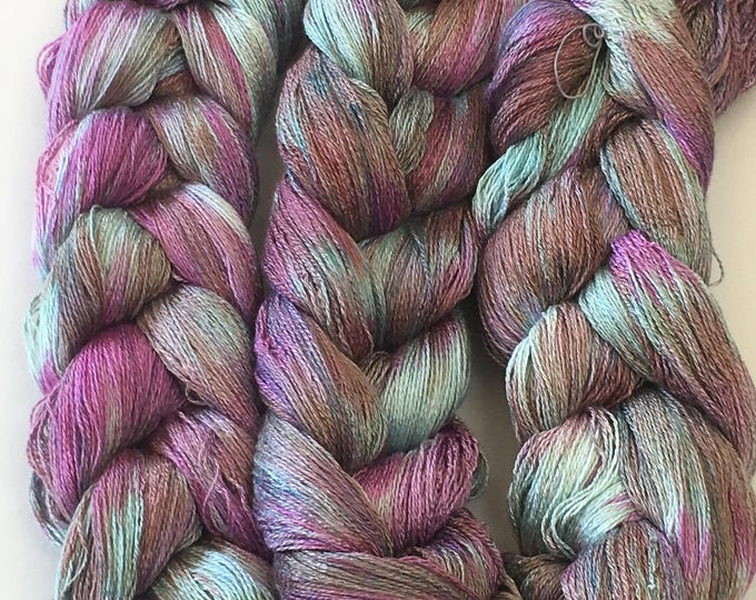 Hand-dyed, pre-wound weaving warp, 8/2 rayon, 400 ends, 5 7/8 yards long, in shades of pink, light green, and taupe -DW29