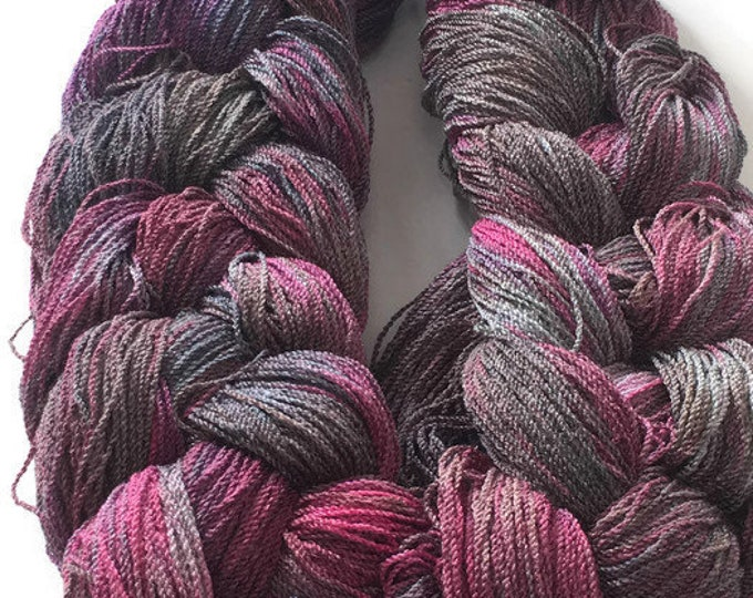 Hand-dyed, pre-wound weaving warp, 8/2 cotton and rayon, 282 ends, 4 yards long, in shades of burgundy, pink, and gray -DW57