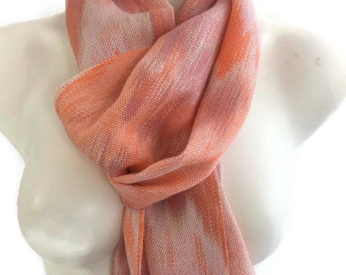 Hand-dyed, handwoven, Tencel, fringed scarf in shades of pink, peach, cream, and orange -TFS25