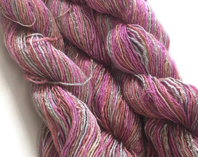 Hand-dyed, 6-ply rayon floss, 200 yard skeins, in shades of pink, salmon, peach, and gray -DY22