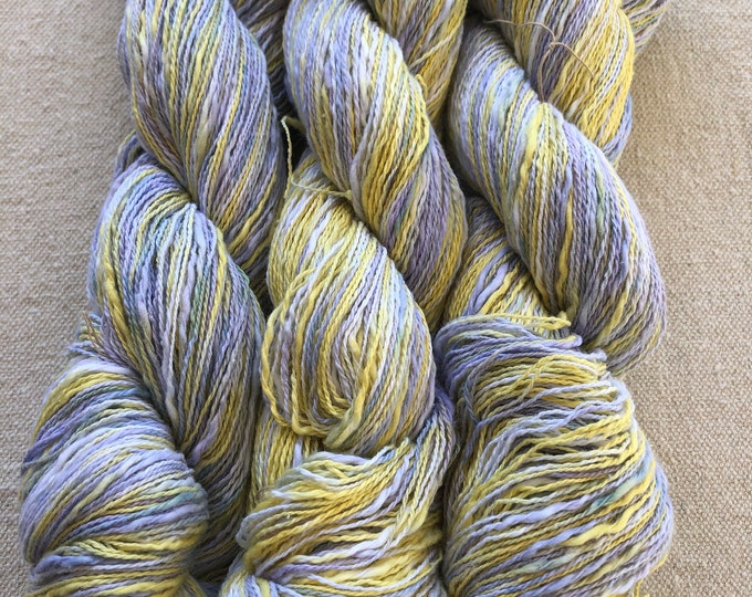 Hand-dyed, 2-ply cotton, thick and thin yarn, 500 yard skeins, in shades of yellow, lavender, and blue