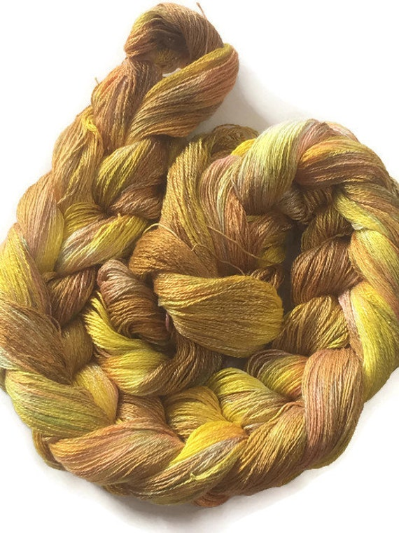 Hand-dyed, pre-wound weaving warp, 8/2 rayon, 300 ends, 3 7/8 yards, in shades of yellow, brown, and peach -DW37