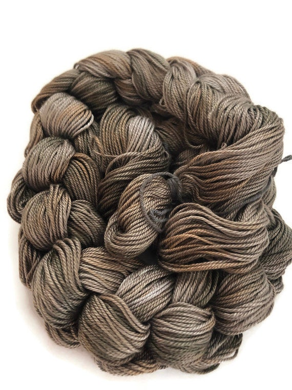Hand-dyed, pre-wound weaving warp, 6.5/3 mercerized cotton, 100 ends, 3 1/4 yards long, in shades of greys and beiges