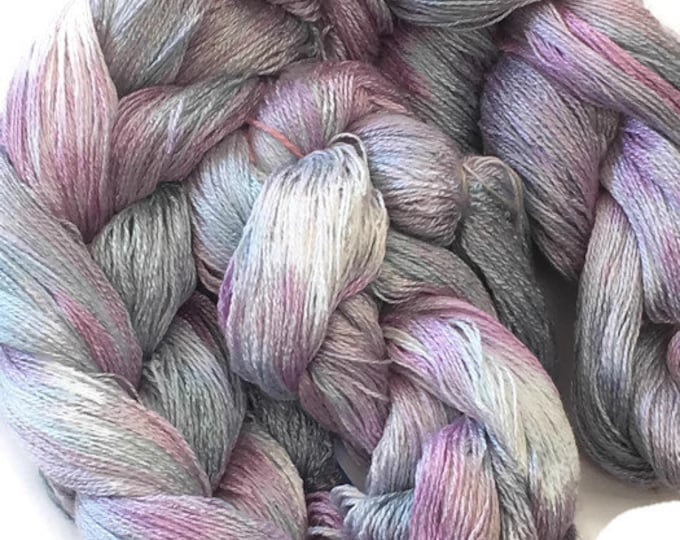 Hand-dyed, pre-wound weaving warp, 8/2 rayon, 400 ends, 3 7/8 yards long, in light shades of blues, pinks, and lavender -DW43