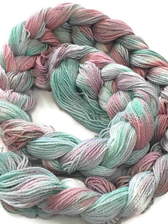Hand-dyed, pre-wound weaving warp, 4/2 cotton, 100 ends, 5 7/8 yards long, in shades of green, pink, and light blue -DW60