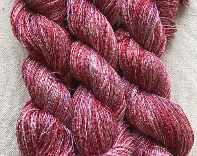 Hand-dyed, 6 strand/ply rayon floss, 500 yard skeins, in shades of brick red, rose, pink, and pale pink