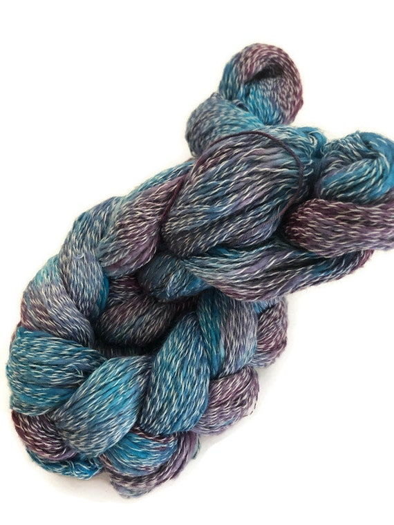Hand-dyed, pre-wound weaving warp, cotton slub with synthetic binder, 300 ends, 3 1/4 yards long, in shades of blues and purples with white