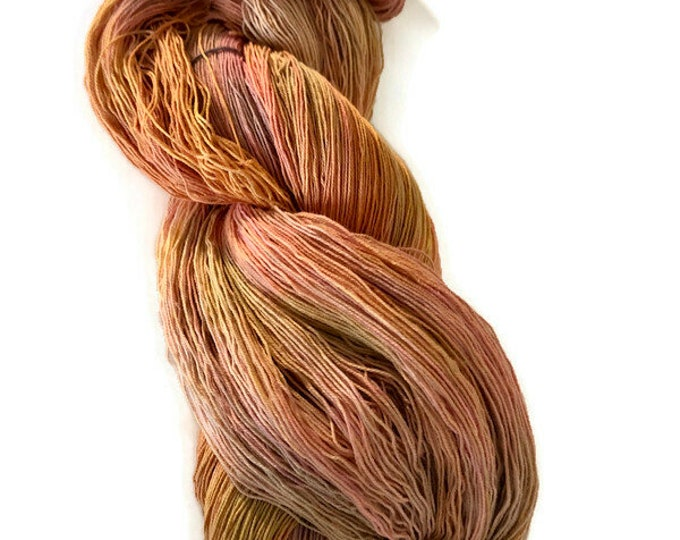 Hand-dyed cotton yarn, 16/3, 1200+ yards, in shades of golden yellow, peach, pink, soft pink, beige, and natural