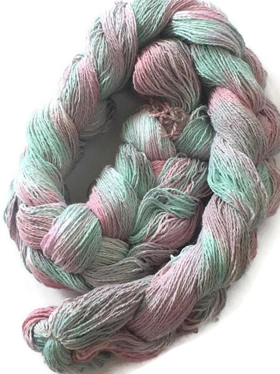 Hand-dyed, pre-wound weaving warp, 8/2 cotton, 200 ends, 3 7/8 yards long, in shades of light green, pink, and gray -DW38