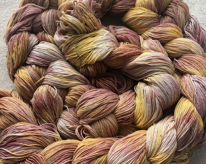 Hand-dyed, pre-wound weaving warp chain, 10/3 cotton, 7 1/2 yards, 300 and 400 ends, in shades of brown, light pink, yellow, and natural