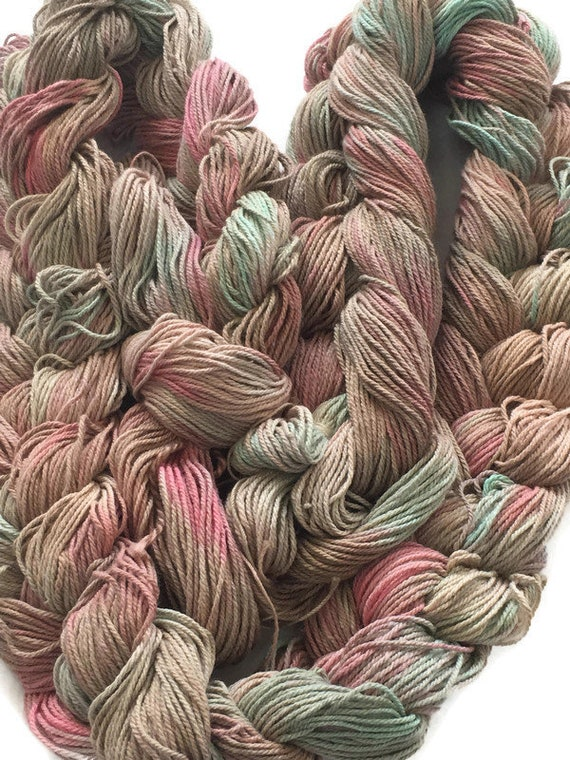 Hand-dyed, pre-wound weaving warp, 10/3 cotton, 100 ends, 5 7/8 yards long, in shades of beige, pink, and green -86