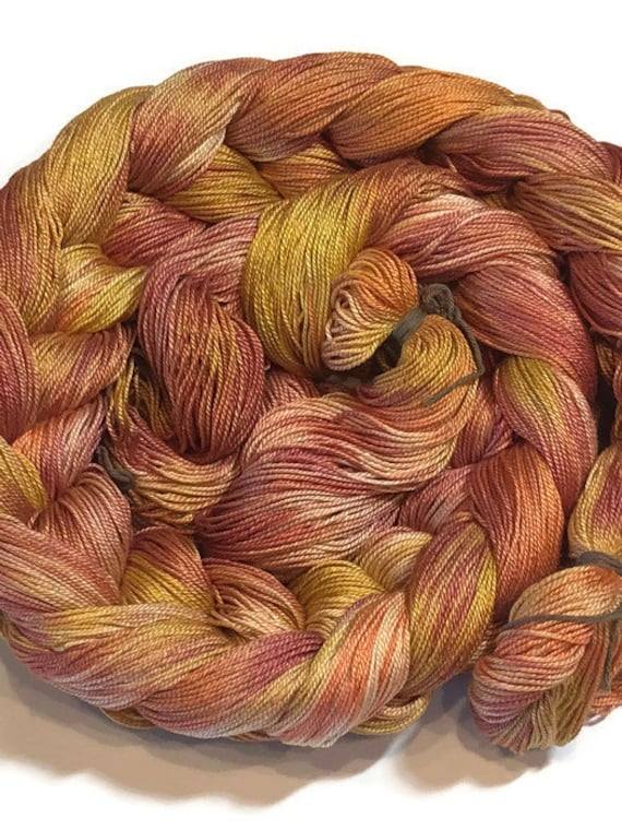 Hand-dyed, pre-wound weaving warp, 6.5/3 mercerized cotton, 300 ends, 5 yards long, in shades of yellow, pink, peach, and orange