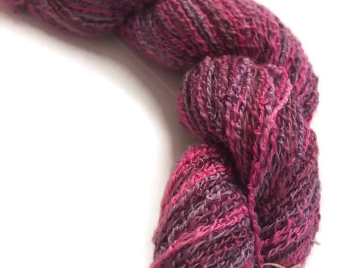 Hand-dyed, cotton and rayon, boucle yarn, 200 yard skeins, in shades of hot pinks and lavenders