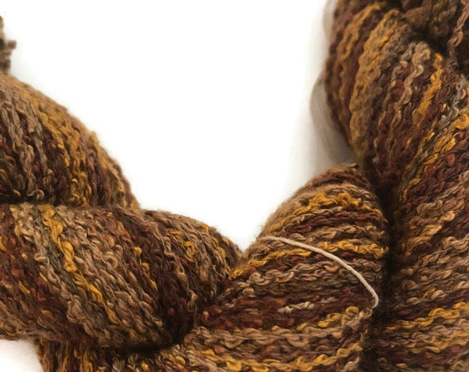 Hand-dyed, cotton and rayon, boucle yarn, 200 yard skeins, in shades dark brown, golden brown, and beige