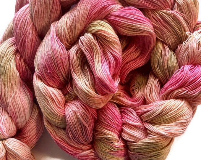 Hand-dyed, handpainted, pre-wound weaving warp, 16/3 cotton, 4 3/4 yards, in shades of pinks and beiges