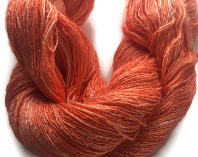 Hand-dyed, rayon 6-ply floss, 500 yards, in shades of orange from light peach to bright orange