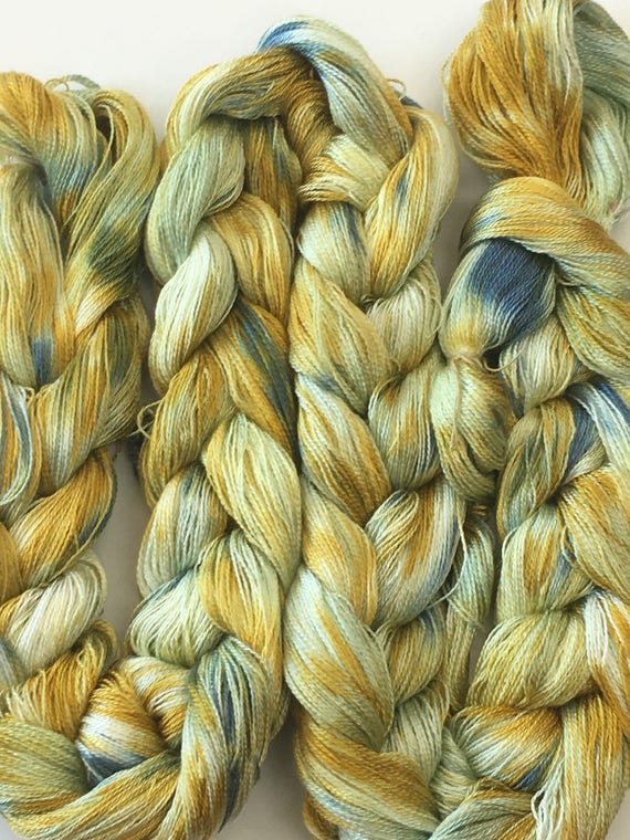 Hand-dyed, pre-wound weaving warp, 8/2 Tencel, 300 ends, 6 yards long, in shades of golden yellow, pale green, and blue -DW105
