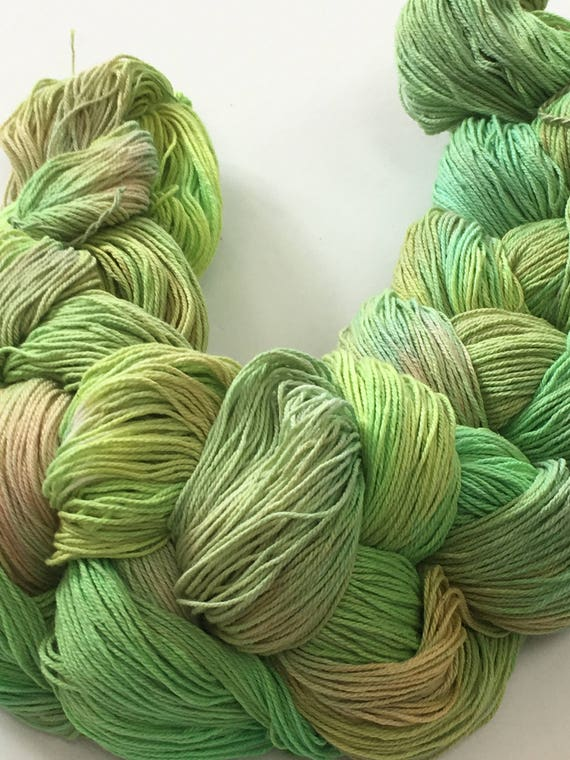 Hand-dyed, pre-wound weaving warp, 10/3 cotton, 300 ends, 2 7/8 yards long, in shades of greens and peach -DW82