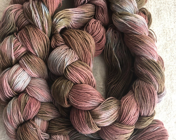 Hand-dyed, pre-wound, weaving warp chain, 10/3 cotton, 300 ends, 5 5/8 yards, in shades of rose, brown, grey, natural