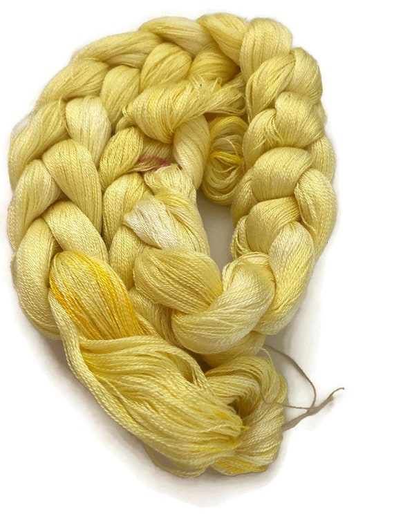 Hand-dyed, pre-wound weaving warp, 8/2 tencel, 300 ends, 4 yards long, in shades of yellow