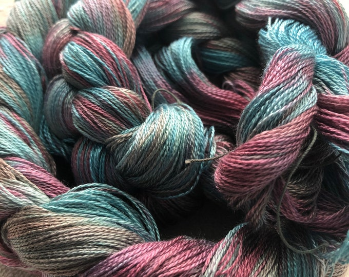 Hand-dyed, pre-wound, weaving warp chain, 8/2 Tencel lyocell, 200 and 300 ends, 4 7/8 yards long, in shades of blues, pinks, and grey