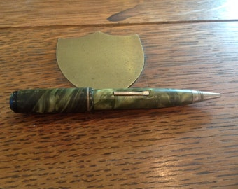 The pocket clip is marked USA Vintage 1950/'s Wearever mechanical pencil black shaft with a gold color cap and