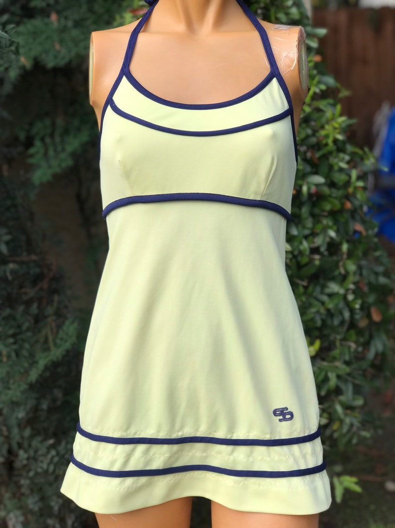 0f87d76dd6442 Vintage 1970s Polyester Halter Tennis Dress. Made by Top Seed. Yellow w  Navy Blue Trim