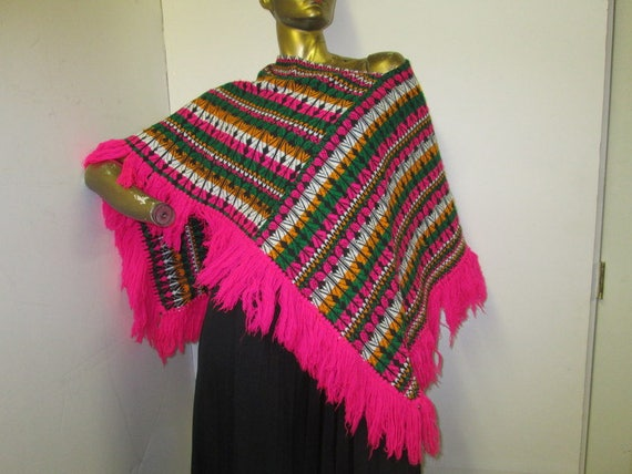 vintage 70s Guatemalan fringed poncho in a vibrant