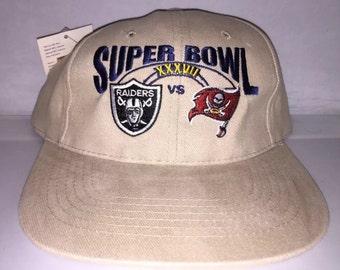 ff1bec02199 Vintage Oakland Raiders Tampa Bay Bucs Buccaneers Super Bowl Strapback dad hat  cap rare deadstock NFL Football 90s jerry rice warren sapp